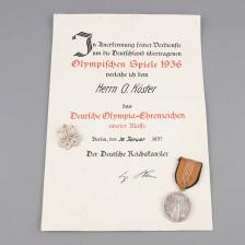 Saksan 2.lk Olympia-ansiomitali kunniakirjalla (Virolainen puolustusministeri Oskar Köster)