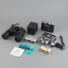 Erä kameroita ja kiikareita