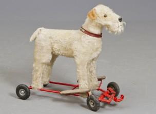 Koira pyörillä