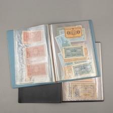 Erä suomalaisia ja ulkomaisia seteleitä kansiossa