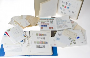 Erä postimerkkejä ym.